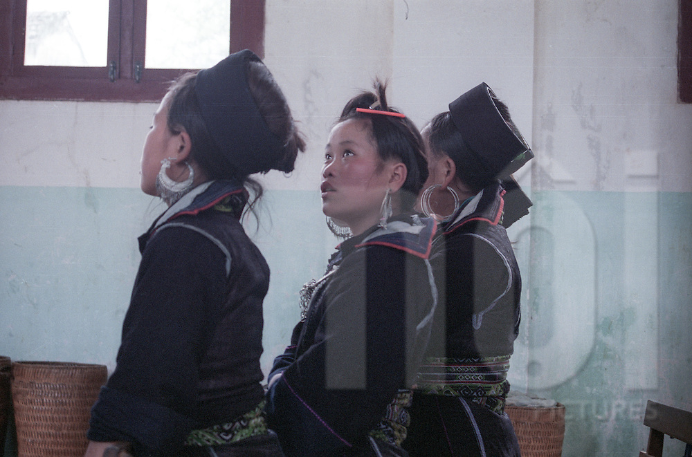 Young Hmong girls attend to the mass in Sapa's church, Vietnam, Asia