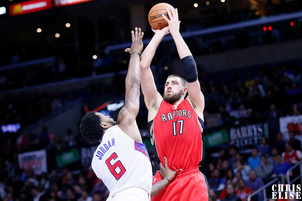 27 December 2014: Toronto Raptors center Jonas Valanciunas (17) takes a jump shot over Los Angeles Clippers center DeAndre Jordan (6) during the Toronto Raptors 110-98 victory over the Los Angeles Clippers, at the Staples Center, Los Angeles, California, USA.