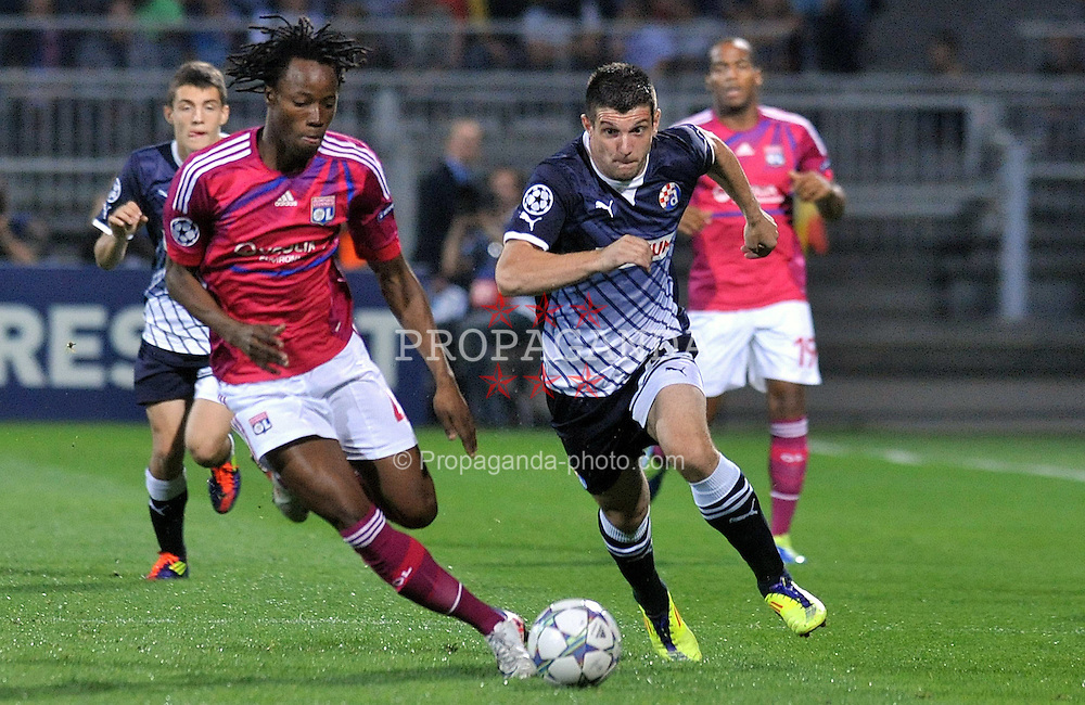 27.09.2011, Stade de Gerland, Lyon, FRA, UEFA CL, Gruppe D, Olympique Lyon (FRA) vs Dinamo Zagreb (CRO), im Bild Fatos Beqiraj (21), Bakary Kone (4) // during the UEFA Champions League game, group D, Olympique Lyon (FRA) vs Dinamo Zagreb (CRO) at de Gerland stadium in Lyon, France on 2011/09/27. EXPA Pictures © 2011, PhotoCredit: EXPA/ nph/ Pixsell +++++ ATTENTION - OUT OF GERMANY/(GER), CROATIA/(CRO), BELGIAN/(BEL) +++++