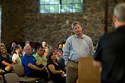 David Medlin asks a question to Dr. Randy Reid of Keller ISD during a town hall meeting hosted by Keller ISD to discuss adding a $175 million bond election to the November ballot in Keller, Texas on August 11, 2014. (Cooper Neill for The Texas Tribune)