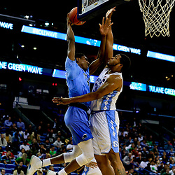 Nov 11, 2016; New Orleans, LA, USA;  Tulane Green Wave guard Melvin Frazier (35) is defended at the goal by North Carolina Tar Heels forward Kennedy Meeks (3) during the first quarter of a game at the Smoothie King Center. Mandatory Credit: Derick E. Hingle-USA TODAY Sports