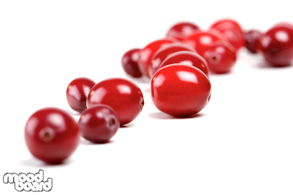 Close-up of cranberries on white background