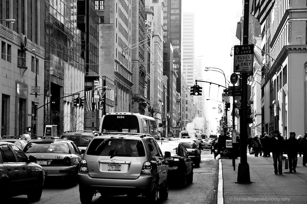 Rush hour traffic on a busy New York City Street, Black and White.