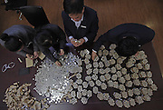 CHANGCHUN, CHINA - DECEMBER 09: (CHINA OUT) <br /> <br /> Fifty Thousands Coins In Note Of 1 RMB To Store In Bank<br /> <br /> Staff of sub-branch Industrial And Commercial Bank Of China at Renmin Square count 50,000 coins in note of 1 RMB on December 9, 2014 in Changchun, Heilongjiang province of China. A company took back its client money of 60,000 RMB (about 9710 USD) which were 50,000 coins in note of 1 yuan RMB and 10,000 paper money in note of 1 yuan RMB. The 50,000 coins in note of 1 yuan RMB was more than 300 kilograms and got difficulty in storing them into a bank due to their inconvenient count.<br /> ©Exclusivepix Media