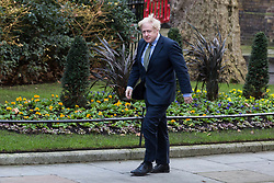 London, UK. 13 December, 2019. Boris Johnson arrives back at 10 Downing Street after meeting the Queen to ask her to be able to form a new Government after the Conservative party won the general election with a majority in the House of Commons of 78 with one seat still left to declare. Credit: Mark Kerrison/Alamy Live News