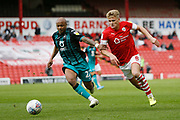 Swansea City forward Andre Ayew and Cameron McGeehan of Barnsley contest a loose ball  during the EFL Sky Bet Championship match between Barnsley and Swansea City at Oakwell, Barnsley, England on 19 October 2019.