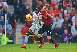 MANCHESTER, ENGLAND - Sunday, February 24, 2019: Liverpool's Georginio Wijnaldum (L) and Manchester United's Luke Shaw during the FA Premier League match between Manchester United FC and Liverpool FC at Old Trafford. (Pic by David Rawcliffe/Propaganda)