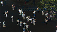 Early Morning Strech and Exercise at Niagara Falls in Shinjuku Chuo Park in Tokyo. Composite of 7 mages taken with a Nikon 1 V3 camera and 70-300 mm VR lens from my hotel room on the 20th floor in the Keio Plaza hotel (aprox. 400 meters distance).<br /> Photoshop, Statistics, Range.