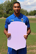 AFC Wimbledon defender Terell Thomas (6) holding Fifa sign during the AFC Wimbledon 2018/19 official photocall at the Kings Sports Ground, New Malden, United Kingdom on 31 July 2018. Picture by Matthew Redman.