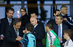 Michel Platini, president of UEFA with Oliver Schnitzler of Germany at medal ceremony after the UEFA European Under-17 Championship Final match between Germany and Netherlands on May 16, 2012 in SRC Stozice, Ljubljana, Slovenia. Netherlands defeated Germany after penalty shots and became European Under-17 Champion 2012. (Photo by Vid Ponikvar / Sportida.com)
