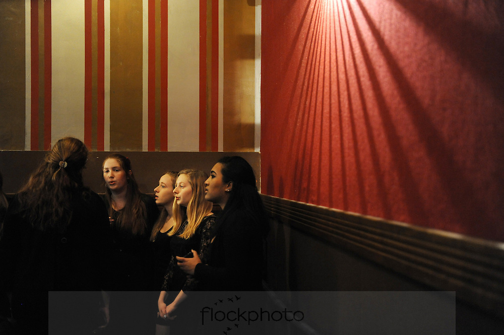 (l-r) Rachel Speyer Besancon, Audrey Stitt, Talia Roland-Kalb, and Queen-Tiye Akamefula warm up with the BHS a capella group Perfect Pitch before Brookline's annual Martin Luther King, Jr. Day event, Jan. 19, 2015.