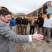 Andy Cantrell, left, discusses the impotance of having working lights and a crossing arm to the school buses during an udit of school safety of the Tupelo Public School District.