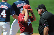 Alabama coach Mitch Gaspard talks with umpire Tony Maners at Oxford-University Stadium in Oxford, Miss. on Sunday, March 20, 2011.  (AP Photo/Oxford Eagle, Bruce Newman)