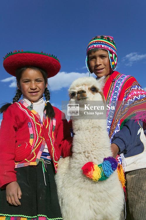 Indian boy and girl with alpaca, Cuzco, Peru