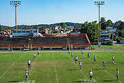 Clairton football players practice at Clairton High School. Even though over twenty percent of the city's families exist at the poverty level — nearly three times the state rate and more than double the national average, and the city has no grocery store, the Bears' 66-game winning streak that ended in 2012 is the longest ever in Pennsylvania high school history.<br /> <br /> The school continually has exceptional winning seasons and has sent many players on to division 1 schools and the NFL.<br /> <br /> Clairton is a city in Allegheny County, Pa., along the Monongahela River. Clairton is home to The United States Steel Clairton Works, the largest coke manufacturing facility in the United States. The plant carbonizes coal to make coke, a fuel necessary to make steel.<br /> <br /> When the Clairton Coke Works employed 5,000 workers and ran three shifts, Clairton had three movie theaters and four car dealerships. Now the plant employs 1,300 workers and residents must drive five miles out of town to buy food since there is no longer a grocery store in town.