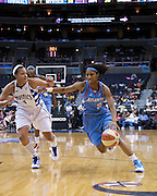 Atlanta Dream's Angel McCoutry tries to get by the Washington Mystics' Marissa Coleman, September 12, 2009.