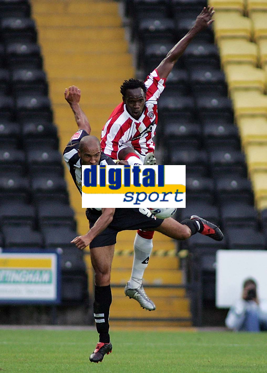 Photo: Paul Thomas.<br /> Notts County v Sheffield United. Pre Season Friendly. 01/08/2006.<br /> <br /> Jason Lee of Notts (R) and Claude Davis go for the ball.