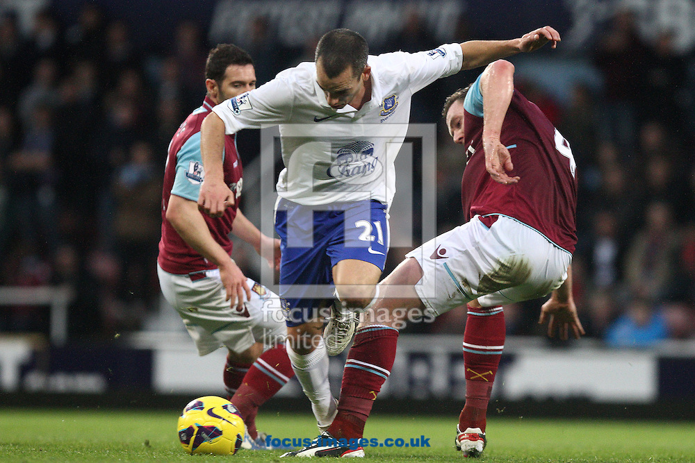Picture by Daniel Chesterton/Focus Images Ltd +44 7966 018899.22/12/2012.Leon Osman of Everton and Kevin Nolan of West Ham United compete for the ball during the Barclays Premier League match at the Boleyn Ground, London.