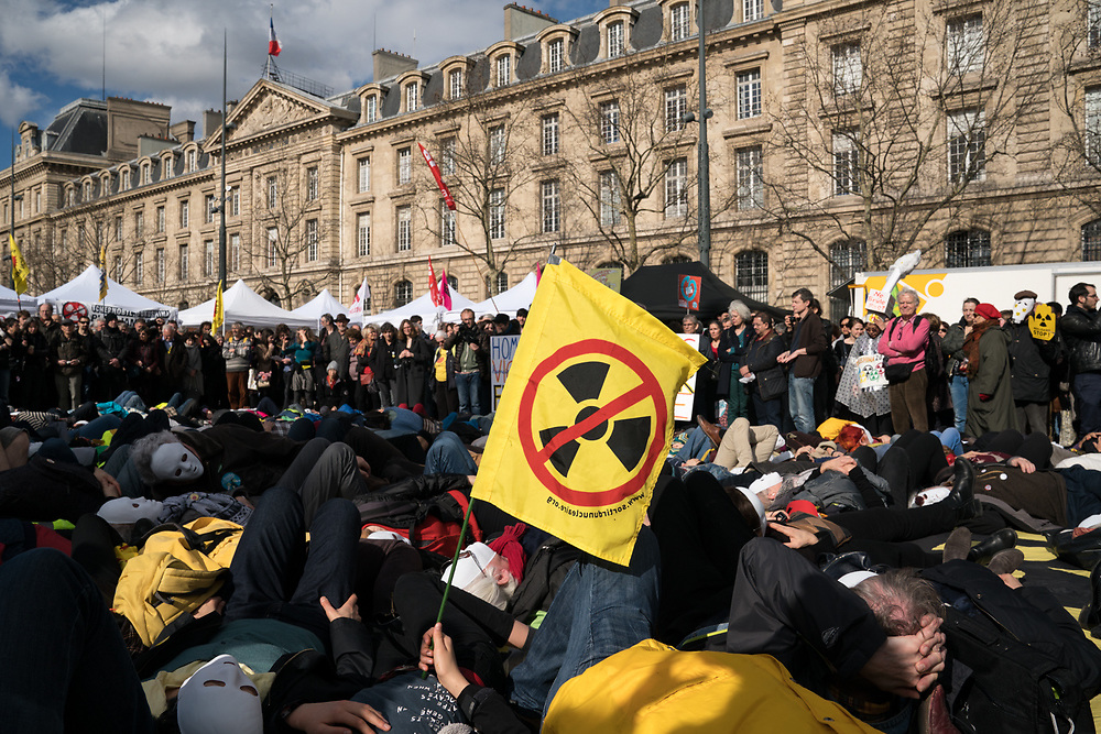 "France, Paris, 11 March 2018. Gathering anti-nuclear in Paris. On the occasion of 7th anniversary of Tofoku earthquake and tsunami which caused nuclear disaster in Fukushima, several associations and political party ""France Insoumise"" organise a gathering to stop nuclear energy in France."