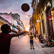 "03/12/2017  OLD HAVANA, CUBA    ""Freddy"" and his two brothers play basketball outside their home in Old Havana, Cuba.  (Aram Boghosian for The New Orleans Advocate)"