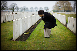 Baroness Sayeeda Warsi looking at the grave of a Jewish Soldier at the Lijssenthoek Military Cemetery in Belgium. Sayeeda is visiting the graves of Commonwealth soldiers on the battlefields of France and Belgium as part of the UK Government's programme to commemorate the centenary of the First World War which starts next year, Wednesday  April 10, 2013. Photo By Andrew Parsons / i-Images