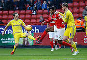 Charlton Athletic defender Ricardo Vaz Te gets his foot to the ball to take it away from Nottingham Forest defender Matthew Mills during the Sky Bet Championship match between Charlton Athletic and Nottingham Forest at The Valley, London, England on 2 January 2016. Photo by Andy Walter.