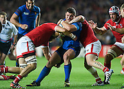France hooker Benjamin Kayser is tackled by Canada lock Evan Olmstead during the Rugby World Cup 2015 Pool D match (22) between France and Canada at Stadium MK, Milton Keynes, England on 1 October 2015. Photo by David Charbit.