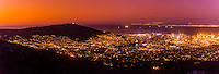 Panoramic view at twilight of Signal Hill and Central Business District with Table Bay behind, Cape Town, South Africa.