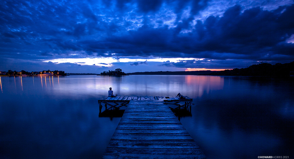 Relaxing after sunset on Lago Peten Itza. <br /> Flores, Guatemala