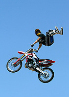 Jul 01, 2003; Anaheim, California, USA; Moto X star athlete JAMIE MCGUIRE executing a tremendous stunt feet free with a full sized motobike at the opening of Disney's California Adventure &quot;X Games Experience&quot;.  Disney park has built two X-Arena's specifically for this 41 day event highlighting extreme sports for the launch of the 2003 ESPN X Games.<br />