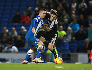 Brighton central midfielder Beram Kayal & Brentford midfielder Sam Saunders tussle for possession during the Sky Bet Championship match between Brighton and Hove Albion and Brentford at the American Express Community Stadium, Brighton and Hove, England on 5 February 2016. Photo by Bennett Dean.