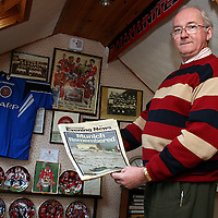 Manchester Utd. fan Noel Howard holding a 1998copy of the Manchester Evening News remembering the Munich crash.<br />