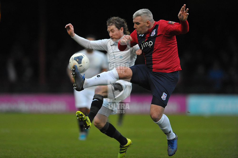 TELFORD COPYRIGHT MIKE SHERIDAN James McQuilkin of Telford battles for the ball with Steve McNulty during the Vanarama Conference North fixture between AFC Telford United and York City at Bootham Crescent on Saturday, January 11, 2020.<br /> <br /> Picture credit: Mike Sheridan/Ultrapress<br /> <br /> MS201920-040