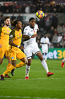 Football - 2017 / 2018 Premier League - Swansea City vs. Brighton & Hove Albion<br /> <br /> Leroy Fer of Swansea City & Gaëtan Bong of Brighton and Hove Albion chase the ball , at The Liberty Stadium.<br /> <br /> COLORSPORT/WINSTON BYNORTH
