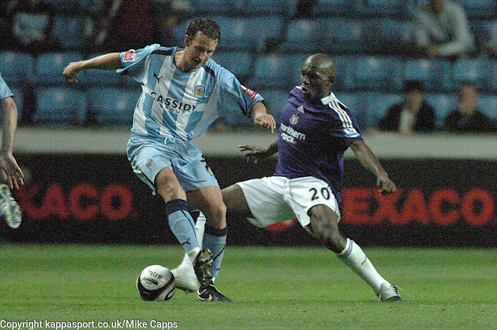 GUILLAUME BEUZELIN, COVENTRY CITY, BATTLES WITH GEREMI NEWCASTLE UNITED. Coventry City - Newcastle United, Utd Carling Cup Ricoh Stadium, Coventry, 26th August 2008 26/8/08