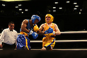 April 1, 2015 - New York, NY. Aaron Katzman (gold) and Chordale Booker (blue) spar during the second match of the night. 04/01/2015 Photograph by Maya Dangerfield/NYCity Photo Wire