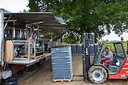 Wine bottling truck with mobile bottling line at Chateau Fontcaille Bellevue vineyard in Bordeaux region of France