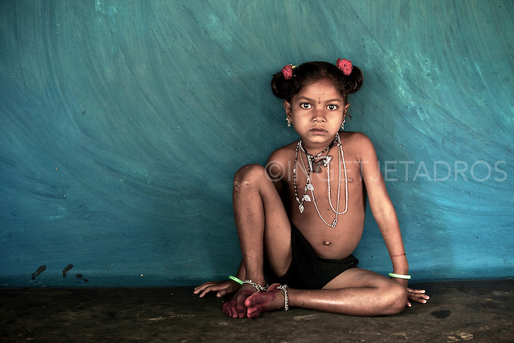 A young girl from the Paroja tribe poses on her birthday with her new necklaces. Orissa, India.<br />