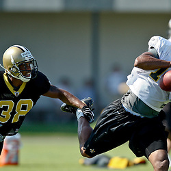 July 31, 2011; Metairie, LA, USA; New Orleans Saints wide receiver Robert Meachem (17) catches a pass past cornerback Mark Parson (38) during training camp practice at the New Orleans Saints practice facility. Mandatory Credit: Derick E. Hingle