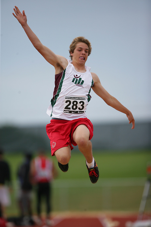 (Charlottetown, Prince Edward Island -- 20090717) Connor Mccumber of Fredericton Legion Track competes in the long jump at the 2009 Canadian Junior Track & Field Championships at UPEI Alumni Canada Games Place on the campus of the University of Prince Edward Island, July 17-19, 2009.  Copyright Geoff Robins / Mundo Sport Images , 2009...Mundo Sport Images has been contracted by Athletics Canada to provide images to the media.