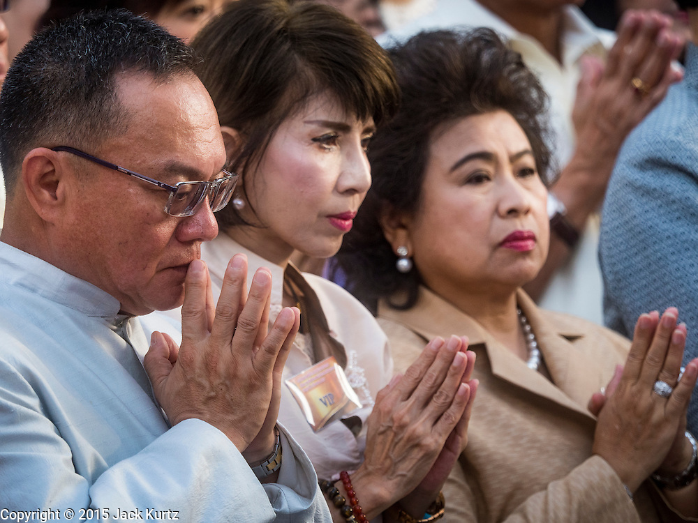 "04 SEPTEMBER 2015 - BANGKOK, THAILAND: Invited guests to the ceremony pray in front of the Erawan Shrine Friday. A ""Holy Religious Ceremony for Wellness and Prosperity of our Nation and Thai People"" was held Friday morning at Erawan Shrine. The ceremony was to regain confidence of the Thai people and foreign visitors, to preserve Thai religious customs and traditions and to promote peace and happiness inThailand. Repairs to Erawan Shrine were completed Thursday, Sept 3 after the shrine was bombed on August 17. Twenty people were killed in the bombing and more than 100 injured. The statue of the Four Faced Brahma in the shrine was damaged by shrapnel and a building at the shrine was damaged by debris.     PHOTO BY JACK KURTZ"
