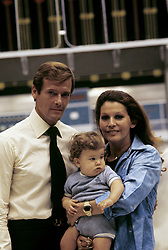 January 1, 1974 - Hollywood, California, U.S. - Roger Moore with wife Luisa Mattioli and son Christian Moore on the set ot ''The Man with the Golden Gun,'' 1974. *** NO ITALY *** NO AMI *** NO SKINS OR TABS  (Credit Image: © Armando Gallo via ZUMA Studio)
