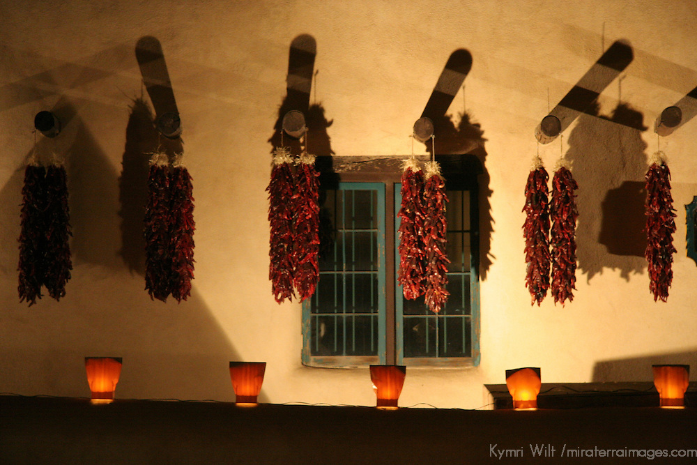 North America, USA, New Mexico. Hanging Chilis alight by luminerias