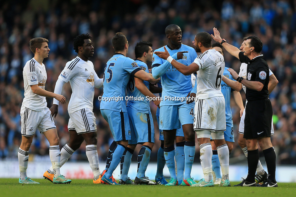 22nd November 2014 - Barclays Premier League - Manchester City v Swansea City - Yaya Toure of Man City argues with Ashley Williams of Swansea - Photo: Simon Stacpoole / Offside.