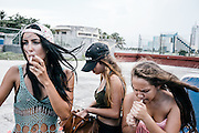 Cuban teens have a smoke during a pool party at Miramar Chateau, a hotel near the beach in Havana.