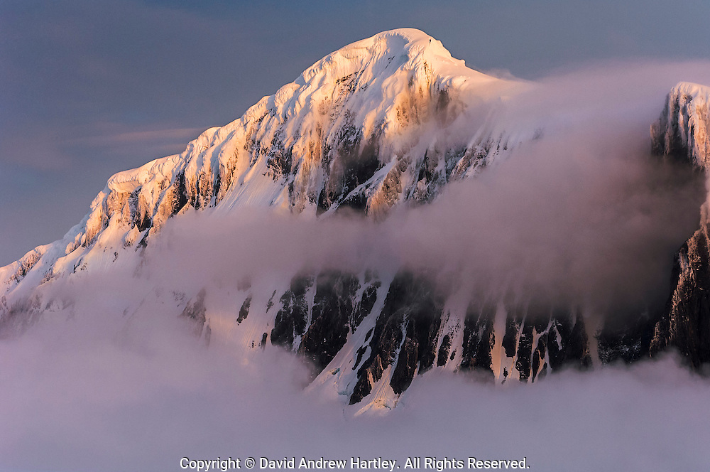 Fog surrounds snow capped mountains, Port Lockroy, Neumayer Channel, Antarctic Peninsula