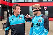 ALKMAAR - 27-07-2016, laatste training AZ voor Europese wedstrijd tegen Pas Giannina , AFAS Stadion, Assistent trainer Leeroy Echteld, AZ speler Rens van Eijden met masker.