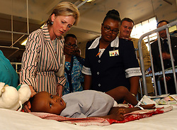 PRETORIA, SOUTH AFRICA - APRIL-26-2004 -.Princess Astrid of Belgium says hello to 15 month old Paolus Thabethe as she and Marc Verwilghen , Minister of Development and Cooperation visit the childrens ward at the Pretoria Academic Hospital. Before the visit, Minister Verwilghen signed a bilateral agreement donating 3.5 million Euros of aid over the next four years to South Africa. (PHOTO © JOCK FISTICK)..<br />