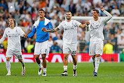 Cristiano Ronaldo of Real Madrid (R) celebrates with his teammates after Real Madrid win 1-0 to progress for the Champions League Final - Mandatory byline: Rogan Thomson/JMP - 04/05/2016 - FOOTBALL - Santiago Bernabeu Stadium - Madrid, Spain - Real Madrid v Manchester City - UEFA Champions League Semi Finals: Second Leg.
