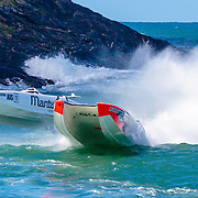 Close combat, Maritimo 1 and Hogs Breath, round a marker, Inboard Engine Class, in the Offshore Superboat Championships Coffs Harbour, New South Wales, Australia